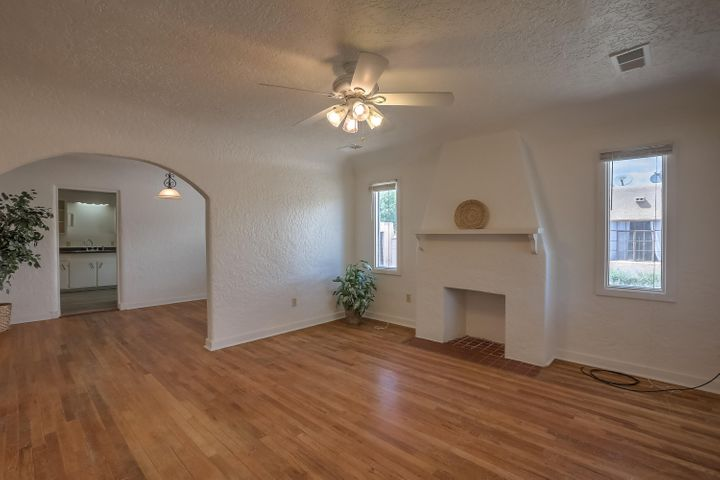 Great location short walk to Nob Hill and close to UNM.  House has lots of charm from the entry  and throughout.  Front rooms have beautiful wood floors, plaster walls and cove ceilings.  Kitchen, hallway and den have new laminae June 2019.  Other updates include TPO roof October 2018, Tankless water heater March 2018, Refrigerated Air Heating cooling combo March 2018, Electrical updated 200 amp March 2018.  1 car garage and large backyard with alley access.