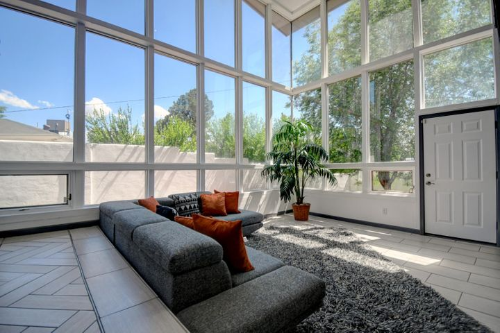 Stunning, light and bright mid- century ranch in the UNM Golf course area! Updates galore with a gorgeous kitchen that has a wonderful bar that opens up to a huge entertaining room. The hardwood floors gleam and the light streams in from all of the picture windows. Plenty of space with 2 living rooms, and an additional large flex room with many possible functions. The home offers 3 nice sized bedrooms, and an additional loft that could be used for an office space, or a guest bedroom. Landscaped front and back with sprinklers '17, new roof, 2 master cools added in 2018 Fantastic 2 ring camera systems and updated ADT alarm sensors. Exterior doors painted as well as all new paint in the home. Don't let your Buyer miss this