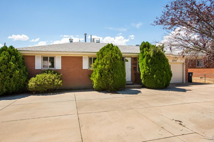 Welcome to this Bright, Beautiful, Single-Level Home in Northeast Albuquerque! 2713 Louisiana offers an Updated Kitchen with Granite Countertops and Stainless Appliances! Polished Wood Floors throughout, No Carpet! HUGE Backyard with Covered Patio and Raised Garden Beds - Perfect for the Urban Gardener! Super-Convenient Location near ABQ Uptown and Coronado Mall! Plenty of Shopping, Dining, and Entertainment Destinations Nearby! Easy Access to Freeway and Kirtland AFB! Make an appointment to see this Home today!