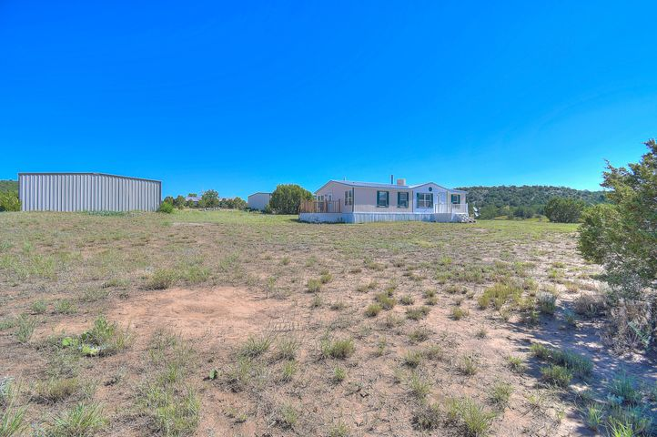 **RESIDENTIAL/ COMMERCIAL OPPORTUNITY) This gorgeous Tijeras property located in the Gutierrez valley has two large warehouses in addition to the manufactured  home. Area is private with amazing views and plenty of room for indoor and outdoor activities! Newer well pump and reservoir tank. These properties sit on just over 5 acres. The larger of the two commercial buildings comes equipped with insulation, water, electric and an oil heater that is negotiable. The smaller building has partial electric and water.