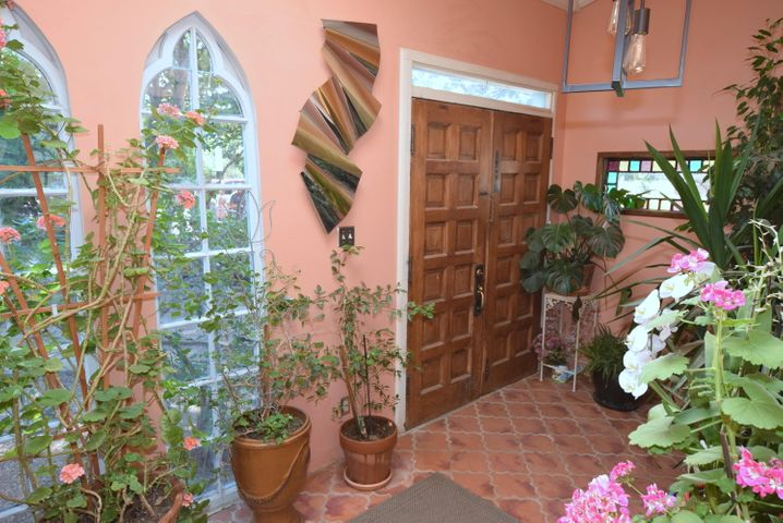 Charm and the true feel of New Mexico await you as you enter this home with the original wood flooring. TWO master suites in the main house and a casita/studio off the newly refurbished pool.The commercial six burner gas stove matches the other stainless steel appliances.You can eat at the counter off the kitchen or sit at the table off the kitchen.  Nice sun room is off the second bedroom.  Large laundry room is off the kitchen. An open patio can be reached from the south master bedroom.The casita has direct pool access, a pellet stove, and 3/4 bath.Steel roof in 2017. Bake bread in the wood burning bread oven in the back yard. New concrete pool in 2018.The three car detached garage is an added bonus. Stop by and check out this multi-generational home. See document of special features.