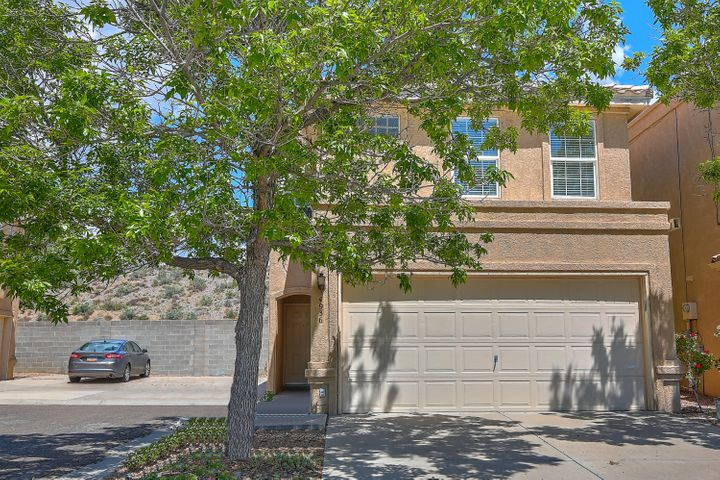 Price Reduced! A MUST SEE, beautifully maintained and updated 1500+ square foot, 3 bedroom 3 bathroom townhome! Relax in the large bedrooms with newer carpet, plus lots of storage room! Double sink in the master bathroom! Find charming tile counters in the kitchen that opens to the living room and dining room for a super spacious feel! Newer wood laminate flooring for a comfortable and bright atmosphere. Also, you get the benefits of a 2-car, garage! The roof has been redone! Outside, enjoy the private walled backyard that has been delightfully landscaped! Located in a cul-de-sac in a wonderful community! Take a walk to the nearby park. Close to food, fun, schools, and shopping! Get in to see this beauty today!