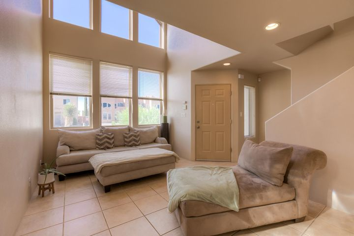 2003 Townhome on a cul-de-sac with raised ceiling and gorgeous picture windows in the living room make this home, light and bright! Spacious living area and bedrooms, owner's suite with double sinks and large closet, it's a perfect starter home or rental! open kitchen living concept, perfect size loft updstairs, recessed lighting, it's darling and it could be your ABQ Dream Home today!