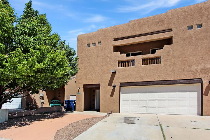 Fantastic find & unbelievably priced, 3 bed, 3 bath townhome with beautiful interior Features. Tall cathedral Vigas ceilings & ceiling fans above a spacious great room with custom Kiva fireplace. Large story windows let in natural light throughout showcasing all the amazing wood details. Granite countertops, newer appliances, attached 2 car garage & 1/2 bath are more of the main floor features. Custom wooden banisters leading upstairs to Master bedroom suite with garden tub & separate shower, walk-In closets & Balcony are main features of the top floor. Covered patio & xeriscaped yard means low maintenance. Less than 5 min from Coors and I40 close to shopping, outdoor activities, entertainment & more.