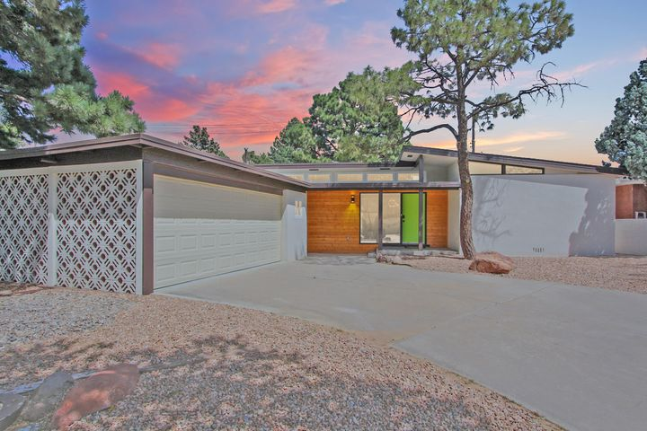 The coolest house in town! This opulently appointed true Mid-Century Home hidden in plain sight! 3 bedrooms, 2 luxurious bathrooms  expansive open air design, beautiful updated flooring, granite freestanding indoor fire pit & freshly updated modern Accoutrements, this is truly one of a kind, the ''Gem of New Mexico''. New kitchen high end stainless steel appliances, including a custom under counter drawer microwave, new range hood, granite countertops, Nest learning thermostat generation e & keyless entry system that links to your owners cell phone Nearly all new plumbing, all updated electrical, fresh xeriscape front & back yard. This home is for everyone and will certainly appeal to your millennial clients. Do not hesitate to bring your pickiest buyers.