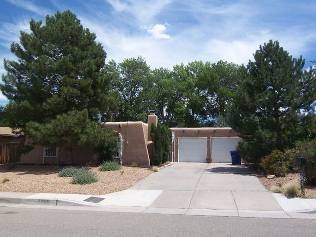 GREAT LOCATION! $239,000. Well maintained 3 bedroom, 2 bath home with 2 car garage & storage. Convenient access to I-25 off San Antonio. Quiet neighborhood with not a lot of traffic. Home is light and bright, with spacious eat-in kitchen with gas stove/oven, great sunroom (heated) and a backyard oasis that is low maintenance! 2 fireplaces: one is unique kiva style (woodburning), the other is gas log. Home has newer roof (2017), sunroom roof is brand new. Mastercool evaporative cooler, updated light fixtures and the aluminum wiring has all been upgraded/pigtailed! 2 car garage with extra 9 x 6 storage room. 10 x 10 shed in the back yard too. (Window coverings & curtain rods do not convey. Please do not enter garage unless owner is present - DOGS!)