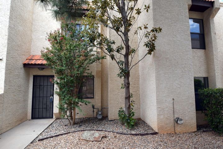 Bright and Clean Townhome In a great location near CNM's Montoya campus, parks and shopping. Washer/Dryer will stay. Walking distance to a Bus Stop and great restaurants.  THIS ''Turn Key'' ready has newer: microwave, water heater, air conditioner and counter tops. Light wood cabinets, ceiling fans, and security. Private patio off kitchen/dining area. Tiled kitchen and Entry.  Gas log fireplace. Across the street from the best Senior Center in the area and a fun cozy neighborhood park.
