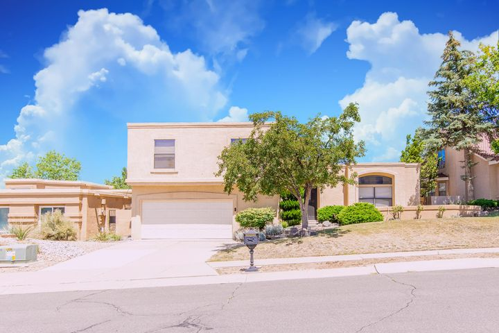 Spectacular home in a very sought out subdivision. Close to the Sandia Mountains and so many outdoor activities. This home features open spaces  and is perfect for entertaining! Don't delay call and take a tour today!Check out the virtual tour!