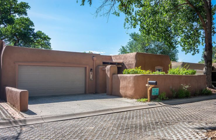 Open house 8/18/2019 from 1-3:00. Come see this meticulously cared-for 3 bedroom home on a quiet & quaint tree-lined street in the North Valley.  Located near the Nature Center, a block from the acequia & just down the street from the best bookstore in town, BookWorks. Amenities include 2 courtyards, wood ceilings & newer windows, a raised garden bed and a deck with seating & planting areas.  Beautifully landscaped the birds & butterflies cannot stay away.  The enclosed sun porch adds an additional 248 sq ft to this 1940 sq ft home. The huge kitchen accommodates a large crowd for entertaining.  Upgrades include new counter tops in the kitchen and bathrooms and lighting.  Open airy floor plan with large sky lights, no need to turn on the lights. Homes on this street sell in record time