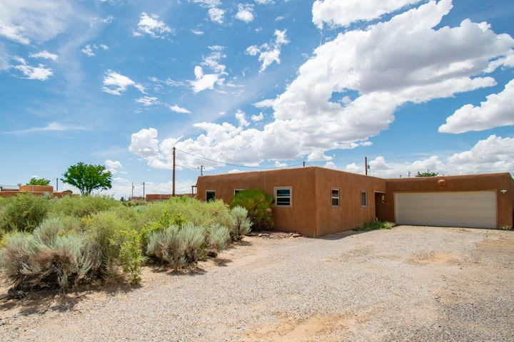 Beautiful pueblo style home! Exposed adobe walls, Brice floors throughout, Viga ceilings throughout, court yeard, custom window coverings. These are  only a few of the amenities in this move in ready home!Home sits on 1/2 an acre lot.
