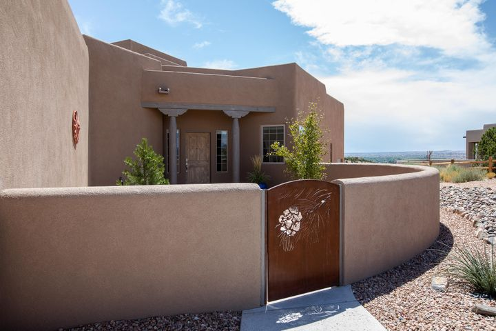 Like new!! This custom 3 bedroom 2 bath 3 car garage home built in 2017 has incredible views of the Sandia Mountains, Mesas and city lights. The cooks kitchen has granite and tile countertops, stainless steel appliances  and custom cabinets. Hardwood floors throughout with carpet in the bedrooms. Large Master suite with walk in closet, jetted tub and double sinks.  Walled front and beautifully landscaped back with covered patio where you can relax and enjoy the beautiful sunsets. Placitas is conveniently located just 15 minutes north of Albuquerque. Close to shopping, restaurants, health care and much more