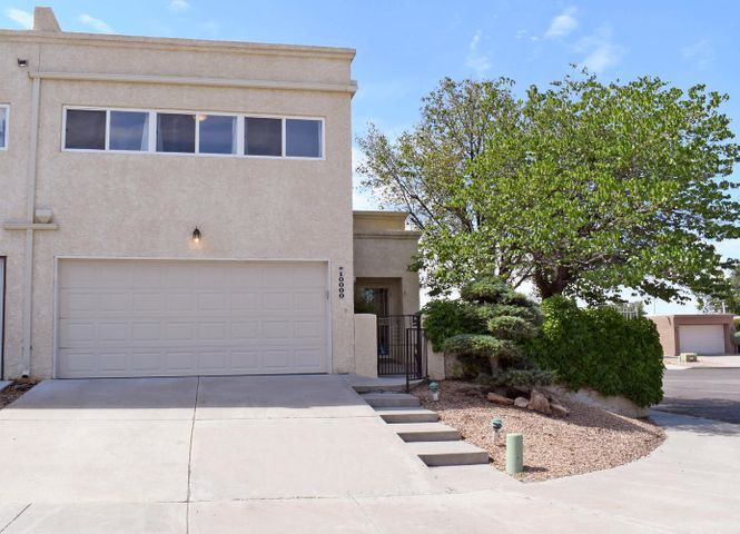 Sensational townhome in prime NE Heights location with NO HOA. Two master suites 1 downstairs 1 upstairs, 2 full baths and a loft that could serve as a playroom, office or bedroom.  The home has been painted and is ready for quick and easy move in. Enjoy a nice cozy lush yard with views of the Sandias.