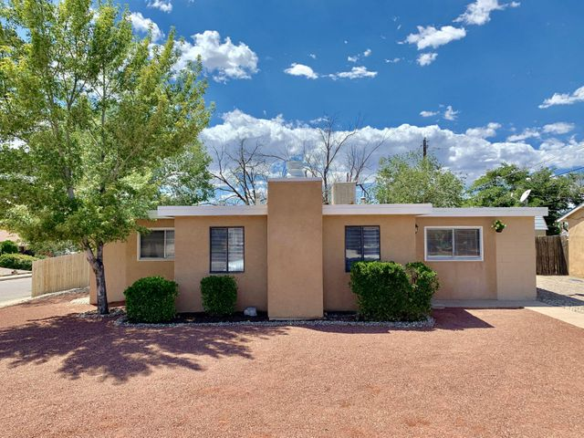 ***OPEN HOUSE Sunday, August 18, 2019 from 2PM - 5PM, if still available.*** HOT, newly-remodeled listing. Centrally-located on a spacious corner lot close to everywhere you want to be in Albuquerque's desired northeast heights! You'll feel at home the moment you cross the threshold and find yourself in the large great room with relaxing wood-burning fireplace.Newly redone throughout including: new stucco & paint, all-new kitchen with stainless steel appliances, updated bathroom, durable new laminate flooring throughout (no carpet!), new lighting and fan kits. Enjoy private outdoor living on an oversized covered patio in the spacious yard. Tired of touring compromising inventory in the affordable price sector? You owe it to yourself to see this home today.