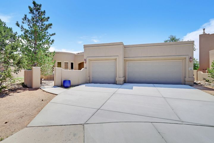 This High Desert Beauty sits on a large 1/4 acre lot on a quiet cul de sac with Fabulous Mountain Views. Enter thru the gated courtyard to the Gorgeous Great Room with Soaring Ceilings, a wall of 18' Windows and a Custom Gas log Fireplace! The Chef's kitchen opens to a breakfast nook with a wall of windows perfect for sipping coffee and enjoying the beautiful views of the Sandias!  Relax in the Master Retreat with a jetted tub, separate, shower, dual sinks, and a huge walk-in closet! The 3 Car Garage is finished and insulated! Outside you will find plenty of room for a pool, big garden, & there's a separated walled backyard w patio. Fresh Paint thru-out, New Carpet,  New Blinds, New Evap Unit,  Wired for Speakers and Fans, Crown Molding and so much more! This lovely home is move-in ready!