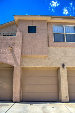 Well maintained condo in a popular gated community of Rancho Encantado.  Easy access to I-40, Montano, restaurants, shopping, and parks.  Home has a open floorplan with two large rooms and 2 1/2 baths.  New paint, carpet,  xeriscaped backyard.  All appliances convey.  Move in ready.
