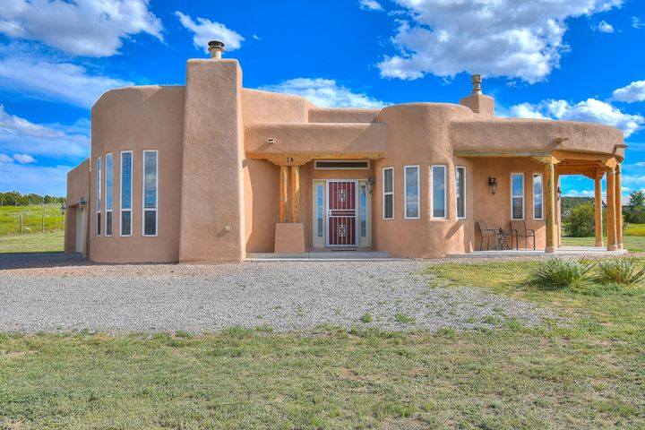 Priced to sell, Don't miss out! Pueblo style luxury sitting on 2.02 acres minutes from I-40, in beautiful Tierra Vista Estates. Featuring 4 beds/2 baths this immaculate home has no shortage of custom features. Tongue and groove ceilings with vigas, nichos, two-way gas fireplace, stainless steel appliances and a breakfast nook. Enjoy cozy evenings by the wood burning fireplace. Relax in the spacious master bedroom with walk-in closet, recessed ceiling and jetted tub. Plenty of natural light and windows to enjoy 360 degree views of beautiful New Mexico skies and mountains.  *Updates include: new stucco, roof, Eco Bee thermostat, new lighting, air purifier, security doors.  Schedule your showing today and make this your home!