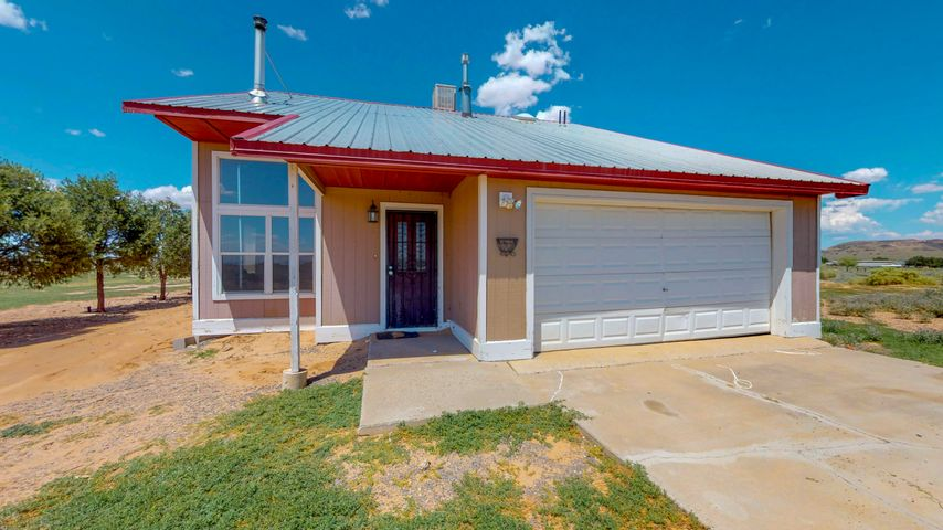 Country living at it's finest!  This adorable 2 bedroom home sits on just under 2.5 acres of land! Just a 10 minute drive from I-25.  Views for Days!  Home features hardwood floors, fully fenced property with round pen, 2 master bedrooms each with it's own bathroom, covered patio, and 2 car garage! Come see this home today!
