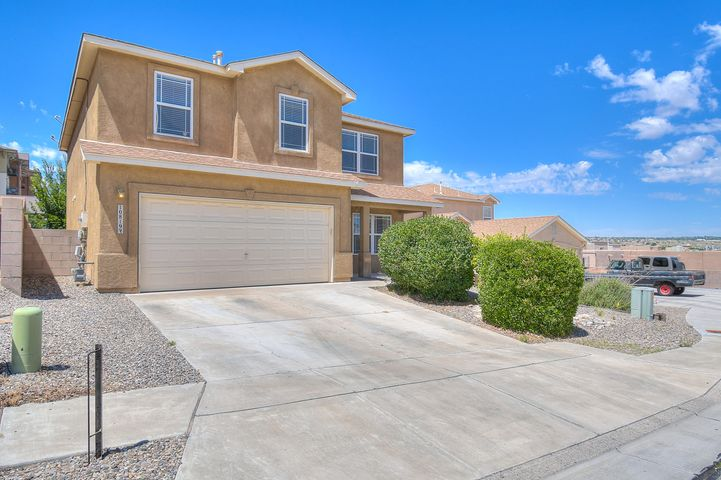 This beautiful 4 bed 3 bath home is located in northwestern Albuquerque. This home features a large living area accented by fireplace, perfect for entertaining with loft above. Kitchen is well lit and features a clean color palette, updated cabinets and tile floors. Spacious master bedroom has walk-in closet and garden tub.  The large backyard features a vast, partially covered, patio and plenty of space for outdoor fun! Schedule a showing and make it yours today!!