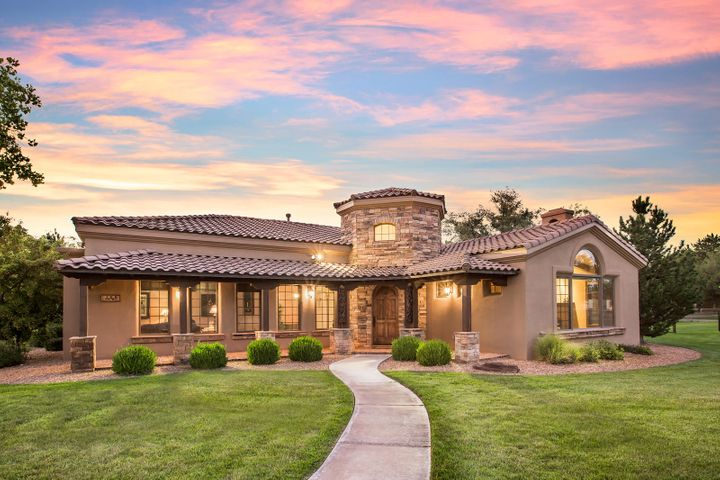 **This is an absolute steal! Seller is relocating and is selling this stunning estate BELOW Market Value.  This home also has the option to be sold fully furnished. Nestled in a luxurious setting with the Bosque at your fingertips. This private Estate sits perfectly on 2.18 Acres -amongst cottonwood trees, sprawling landscape and piercing views of our beloved Sandia Mountains. -Walk, run, bike and ride your horse on tree lined trails. This 4,162 square foot home offers 3 bedrooms, all with private en-suite baths and walk in closets. The kitchen features Alder cabinetry, Granite countertops and Wolf Sub-Zero appliances, Custom range hood, and a 5 burner gas cooktop. -Anderson wood/clad windows throughout, along with Oak and porcelain flooring. Oversized 3 car garage that measures just shy
