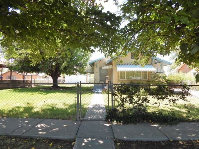 Absolutely charming home on a large lot.  2 bedrooms, 1 full bath, oversize 1-car garage and 514 sq ft shed. Country Kitchen has dishwasher, microwave, stove & disposal.  Freshly painted, new water heater and a new metal roof.  Completely fenced and has beautiful landscaping with large trees, shrubs and grass.  Great location close to all City conveniences.