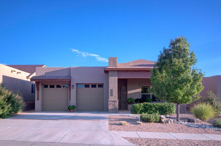It's a Beauty! This ENERGY STAR certified NM Green built Paul Allen home  has been well maintained.  Step into the large living room dining room combination designed with flexibility in mind. Spacious kitchen is equipped with all stainless appliances including gas range and the refrigerator stays! Kitchen is open to family room with built in book shelves. Large Master suite includes 2 closets, (one walk in). Roomy master bath w/ double vanity,separate shower and garden tub. Fully landscaped, with inviting covered patio, and backyard privacy. You will love the low energy bills, tankless water heater, energy efficient living. Come and discover this lovely one level home for yourself! ( Brass light fixture in LR and light fixture in walk in closet in Master do not convey)
