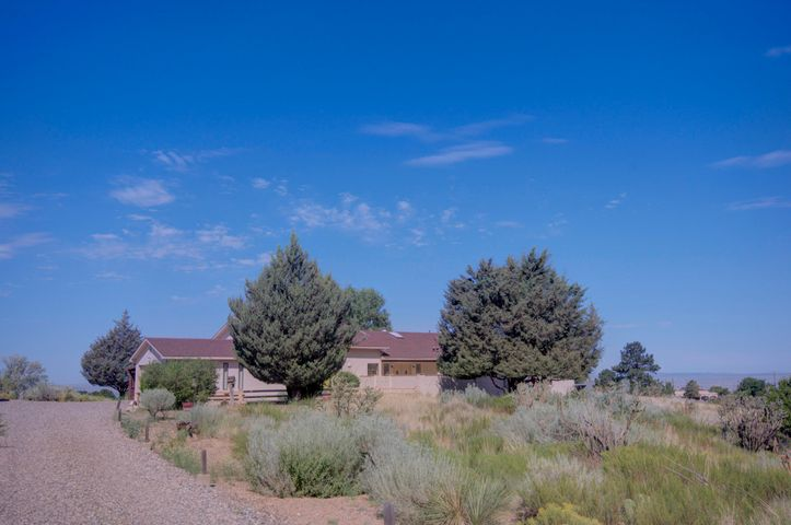Looking for a special home to make your own in Sandia Heights?  Come see this 2655 sf 3 bedroom /3 full bath plus huge office home on 1.04 acres in prestigious location with great Sandia mountain and city lights views.  Spacious  ''great room'' with high ceiling and full height custom fireplace built from rare petrified wood. Large office/den/ playroom or fourth bedroom has fireplace plus interior, and separate outside, entrances. Second bedroom is very large has its own full bath & could be a SECOND MASTER bedroom. Cheerful sun room, large covered patio , two car garage & 1 car carport make this home very livable. The views from this lot are extraordinary.  Watch the sun set over distant Mt. Taylor and see the rosy glow on the Sandias!  Pre-inspected. Don't miss this great opportunity !
