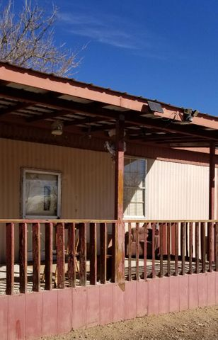 VALUE*VALUE*VALUE!Looking for a deal? This home has had all the  BIG TICKET items replaced: Recently New Plumbing, New Furnace, New Hot Water Heater, New Electric Pole, New Electric Meter, New Washer New Dryer!1/4 AC MH Small Workshop Huge Open Patio with Carport and Deck!  Charming Vintage 2 BR 1 bath with raised Kitchen and Retro Mirrors  and Wooden Overhang!  Bring your ideas, customize this home! Home being sold ''AS IS'' due to budgetary constraints. Corner Lot fully fenced with plenty of room for renovation! THISIS A 1978!