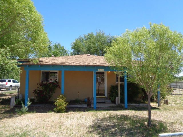 Here is your own ranchette 2 bed/2 bath house on 1 acre! This terrific adobe home has remodeled kitchen, baths and flooring. Spacious living/dining room. Master suite has walk-in closet and shower. Large 2nd bedroom with access to open patio. Open area between bedrooms is used as an office with built-in cabinets. Some exposed hard wood floors. Washer and dryer connections in the main bathroom. 9 x 12 enclosed patio off the kitchen. Refrigerated A/C. Detached outbuilding with power and water.  Dog runs.  Property is fenced and cross-fenced.