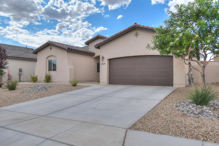 This beautiful home is located in northern Rio Rancho. Kitchen is highlighted by beautiful cabinetry, counter-tops, and island.  Stunning master bed and bath feature walk in closet, double sinks and beautiful tiled shower. Features include, gorgeous open floor plan and fully Xeriscaped backyard, ready for entertaining! Backyard is tied together with custom water feature. This home won't last long! Schedule your showing today!