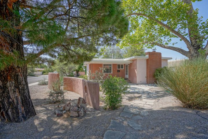 One story UNM/Nob Hill home on a corner lot with a large floorplan, 2 living areas, refrigerated a/c, hardwood floors, newer roof and 2 car attached garage. Large master bedroom with fireplace could also be another living area if needed. This fabulous home won't last long at this great price.