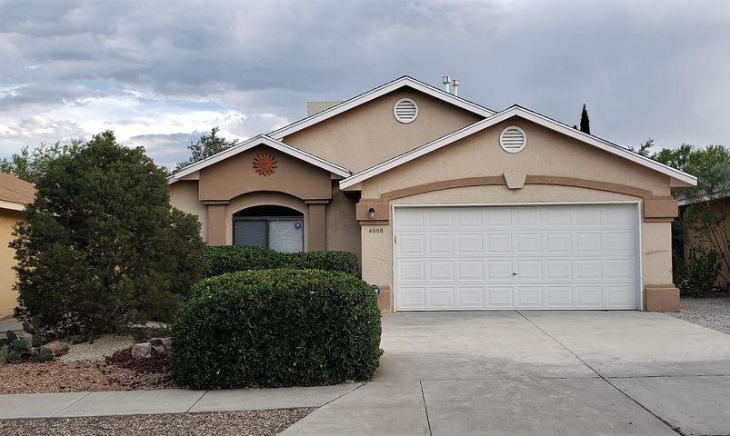 Come check out this Amazing ONE STORY beauty close to shopping, schools and hospitals! Tons of updates including both bathrooms with stunning details. This home has no carpet!  Beautiful hardwood laminate flooring throughout with tile in bathrooms and kitchen.   High vaulted ceilings offer a large open area in the living room with the kitchen conveniently located to entertain and have access to the back yard. Enjoy the covered patio with low maintenance landscaping in both front and backyard. Move-in ready! Come check this out today. This one won't last long!