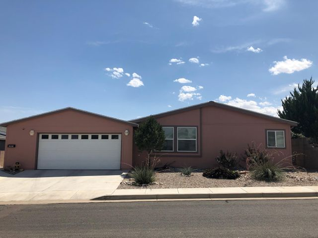 Great open floorplan in the 55+ gated community of Sunrise Bluffs. Large 3 bedroom with an office(possible 4th bedroom) and 1 3/4 baths. Kitchen has upgraded appliances. Skylights bring that natural light into the home. Oversized 2 car garage has plenty of room for 2 full size trucks and storage. Enjoy those beautiful New Mexico evenings out on your covered patio that is beautifully landscaped with a firepit. The community has a clubhouse, enclosed heated pool, exercise room, recreation building, billiards room and large covered patio.Don't miss this immaculate home. Make your appointment today.