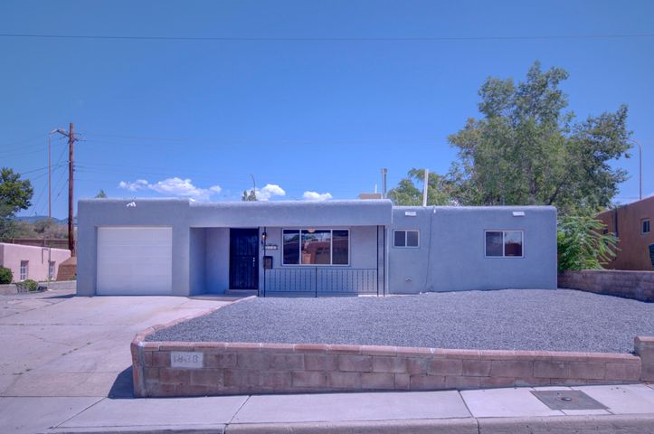 Tons of natural light fill up this wonderful home featuring a spectacular kitchen with subway tile backsplash,  new quartz countertops, stainless steel appliances and large pantry. 2 wonderfully appointed living areas featuring skylights and a wall full of windows. New TPO roof, all New flooring, New Evap cooler. New fixtures, ceiling fans. New paint inside and out.. Extra space available in the 12x20 workshop in backyard.