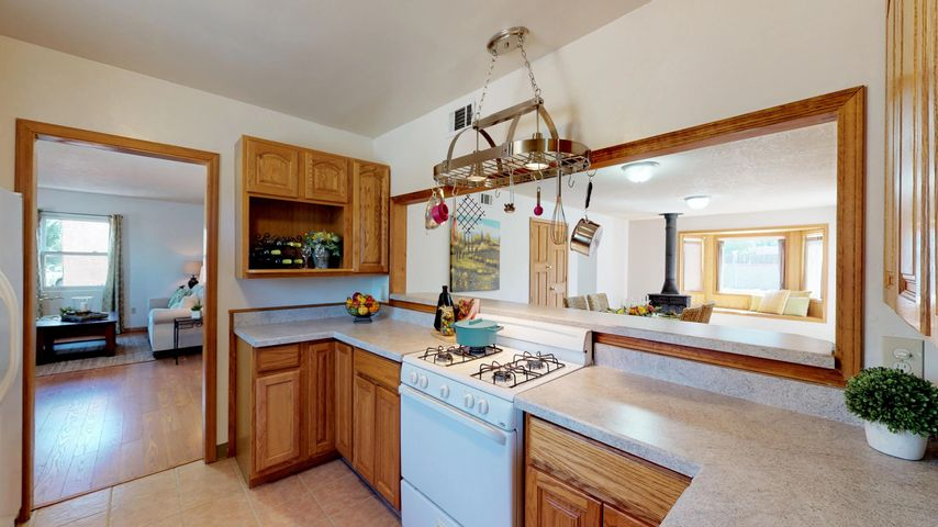 Affordable Pueblo style home near Indian School & San Mateo. South of I-40 about 1/2 way between UNM & Uptown. With 3 bedrooms, 1.75 baths, kitchen which opens up to dining/family area and 2nd living room.  New carpet, paint, french doors to back yard, kitchen sink and faucet.  Newer Master Cool & thermal windows. Backyard alley access and plenty of room for a pool, trees, garden or whatever you would like. Close to I-40, bus lines, shopping and restaurants.
