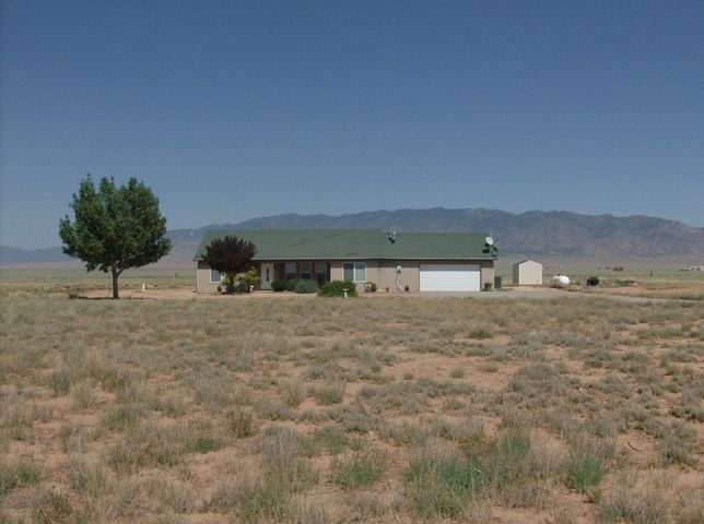 Home in almost new condition, immaculate inside to outside. 4 bedrms., master at south end of home. Nicely landscaped with unobstructed mountain views. Ample kitchen cabinetry, quartz counter tops. Access to patio from the living room. Formal dining rm., breakfast nook in kitchen, large 11 x 7 utility rm. off the kitchen with space for washer, dryer, freezers, deep sink. Over sized garage with small work area. Come see this very pretty home.