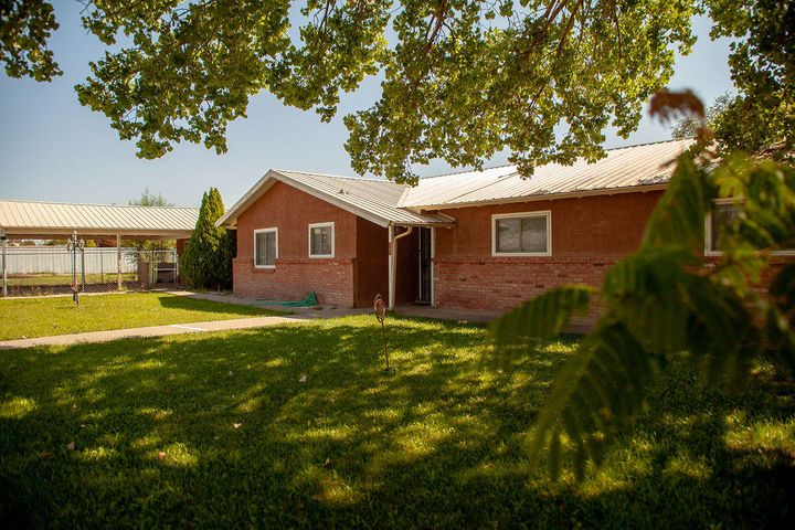 Large country home, includes detached 2 car garage w/ workshop that has 1/2 bathroom, 220 V for welding or to charge Eco car, 42'  RV covering, casita w/electricity & water, horse barn/tack room, covered 2 car carport, garden well. Newly remodeled custom kitchen with all new appliance, custom cabinets w/ pull out, granite counter tops. Touch free under counter cabinet lighting and faucet. Master bedroom has a private patio. Large family room with wood burning stove, Living room has fireplace. Recently install high efficiency hot water heater and forced air heater, electrical panel. Rear patio has fountain, hot tub and custom pergola 300 year old Teak wood patio door, and the list goes on... Inspection have been completed.