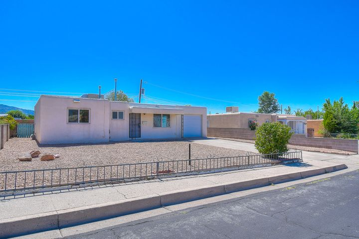 This charming home located in northeastern Albuquerque is a perfect investment property! Home features two large living spaces with tile floors throughout.  The huge backyard with trees and flowers is ready for your own personal landscaping touch! Schedule a showing and make it yours today!