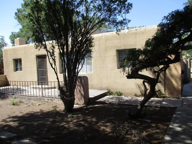 Fixer Upper with fantastic upside potential. Great location, close to Old Town, Interstate, restaurants, walking and biking trails. Just west of Rio Grande Blvd-North of fwy,  Attention Investors Fixer upper or live in and build sweat equity. Has two large living areas, retro kitchen, Hardwood floors, wood burning stove and fireplace, with some fixing up could be a great home. Nice secluded front courtyard. All cleaned out ready for your creative touches.  Being sold AS IS condition. Actual lot size to be approximately 7850 SF waiting on final approval process of splitting lot. Will install back yard fence once points are established by survey company. Cash only deal will not qualify for traditional financing.
