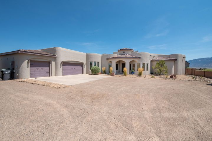 Truly One Of The Most Beautiful Custom Home In Rio Rancho- A Masterpiece With A Custom Spanish Mediterranean designed home Almost 2800' square feet 4 bedrooms, 3 baths with a oversized 3+ car garage and ASTOUNDING MTN VIEWS sitting on .625 acres. Location with easy access to Hwy 528, close to everything! Open floor plan, Cathedral Tongue and Groove Ceiling. Granite counters, Island, Custom Cabinets. Tile floors throughout. Built-in Media Space, Skylights. Master Suite with Fireplace and VIEWS and a separate entrance. Jetted tub, Snail shower, split vanities, walk-in closets. Impeccably maintained. New front xeriscape. Room for large RV with easy parking by garage. Backyard with room for pool/tennis courts, or your palette to draw upon. This home exudes charm and style - Shows like a Model.