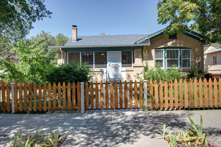 This lovely downtown bungalow invites you to step into old world charm and graciousness but has many modern conveniences and updates.Beautiful windows and atrium doors flood the home with natural light.The home has been recently painted and the hardwood floors gleam.  The kitchen and bathrooms have been nicely re-done and  the home has refrigerated air!  The amazing porch is a perfect sitting area to take in the ambiance of the Fourth Ward district and to look out to the low maintenance, landscaped front yard.Sideyard solar gate opens to parking and a carport.The 600 sq ft basement is a walk out and offers an additional heated room that could have several diferent purposes.Truly unique and charming home!