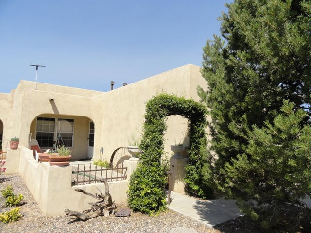 Welcome Home! Lovely town home near the Tierra Del Sol Golf course. Exposed beams in main living area, arched door ways, Generous bedrooms. Nicely landscaped front and back. Private rear yard with several fruit trees and easy maintenance. Comfortable living in well cared for neighborhood just moments from the golf course.