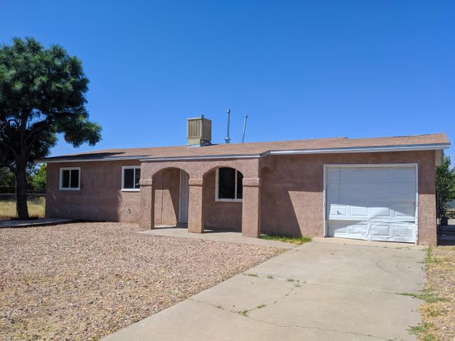Come see this great starter or rental home in Sandia Vista Park close to I-40 & shopping. The home needs some TLC. Bring your imagination and see the opportunity!
