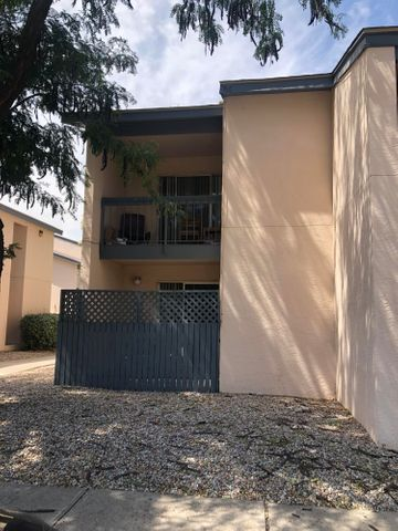 Darling 2 Bedroom, 1 Bath Condo!  Separate living/dining areas.  Private covered patio.  Wood laminate flooring.  Easy access to the freeway and shopping.  End unit!