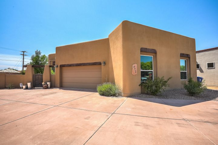Custom built by John Lowe, this Southwest modern adobe-style home is located in the desirable Las Ventanas gated community. Features including: Large kitchen skylight, diamond plaster kiva fireplace, vaulted ceiling in living area with tongue and groove ceilings with beams, granite counter tops, Travertine tile, formaldehyde-free carpet in bedrooms, accent walls, textured walls, niches, open floor plan, custom tile applications, custom Alderwood cabinets, all-Bosch kitchen appliances. Star Energy Qualified and Build Green NM Bronze Certified! Located just minutes from the Bosque, trails, Old Town and soon-to-be completed Sawmill food hall and retail marketplace.