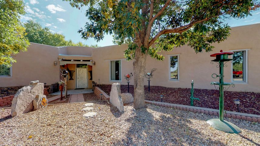 Magnificent horse property on your own slice of New Mexico Paradise. Many charming features including beautiful viga ceilings throughout the classic southwest custom adobe home. Plenty of room to roam on 7.7 acres and minutes from town. Pipe fenced and ready for the horses with 5 stalls and tac room. Newer HVAC and well. Virtual tour, survey and floor plan available upon request. Schedule your showing today!
