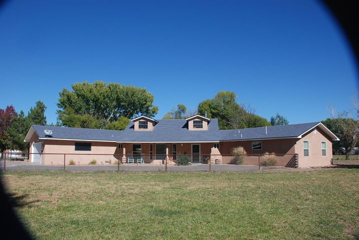 Gorgeous Home! Gorgeous Setting!  Home has been Beautifully Renovated and sits among Mature trees and plantings on Eight Acres of Irrigated Permanent Pasture. Home features a HUGE Great Room with space for pool table and entertaining. Cross Fencing and Play Area create a special play area for children. Entire Property is Fenced in Pipe and Safety Wire for Livestock and Pets. Storage building is a bonus for hobbies or projects. Quiet Rural Location only a short drive to Albuquerque. Advance Appt. Required.