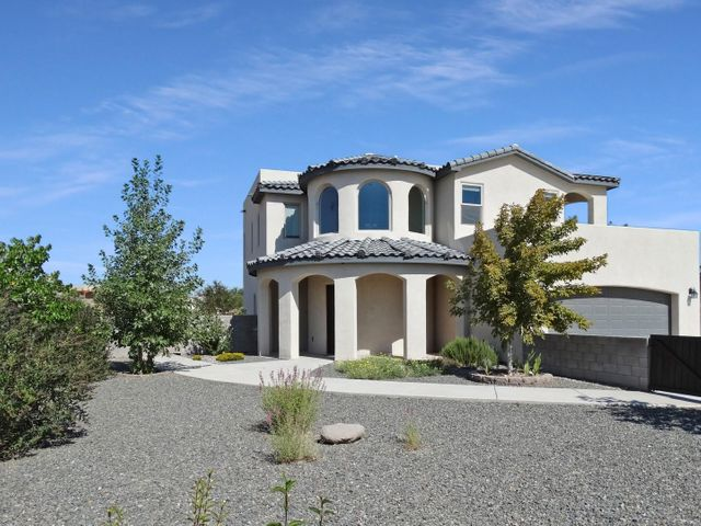 Check out this beauty in Rio Rancho Estates! Mediterranean Styled Custom Built 4BR/3BA 2 story home on a landscaped half acre lot. 4 Years new! Great views of Sandias. Granite counters in kitchen and all baths. Stainless appliances all stay. Double height great room with fireplace and clerestory windows. Open floor plan. Majestic entry foyer. Master has tile shower, private toilet, his/hers vanities, jetted tub and private balcony to view the Sandias. Covered patio & outdoor kitchen with built in grill, a smoker and pizza oven too! Entire property is landscaped, block wall fenced and sprinklered, with fire pit, vegetable garden, herb garden, & several fruit trees. No HOA. Easy access to 528. Security system with cameras. Laundry upstairs. RV Parking with security gate. Don't miss this one!