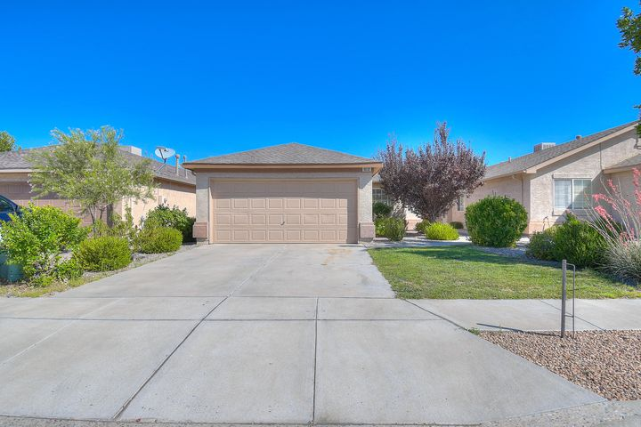 This beautiful home is located in an excellently groomed gated community in Northwestern Albuquerque. The home features many amenities including new roof with solar panels that will be paid at closing. A well landscaped front yard.  Spacious living room features new carpet and cozy gas log fireplace.  The kitchen is highlighted by new stainless steal appliances  and tile floors. Bedrooms and bathrooms have been well maintained and have updated fixtures.  The master bedroom's main feature is the walk-in closet with built-in storage, while tile flooring accents the master bath.  This gorgeous home has too many updates to list. It wont last long, schedule a showing and make it yours today! Owner Financing considered. Call broker for more information on solar panels and owner financing.