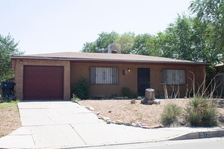 A wonderful home in NE Albuquerque. 3 Bedroom, 1.75 Bath, 1 Car garage.  Recent updates in the past few years are a New Roof (4 years old), Water heater, Laminate wood floors. Carpet and Swamp Cooler are bran new! Come take a look at this house before it's gone.