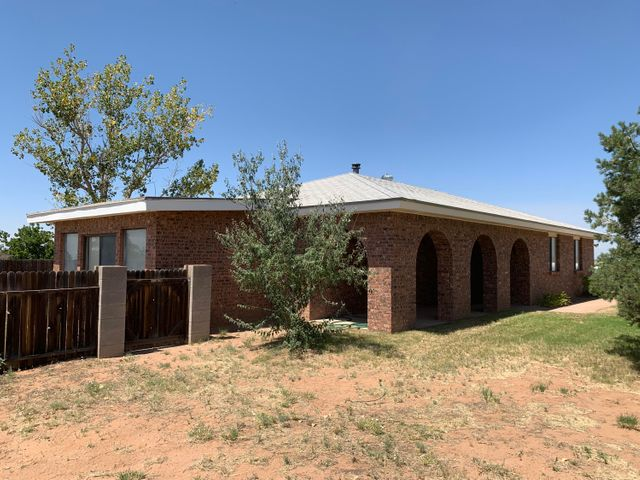 This custom home sits on 5 acres with a large RV/work shop on the property.  This home has allot of living space to include a sunroom.  The views are just amazing.  The landscaping has sprinklers, fenced back yard with mature trees, some fruit trees in the back and allot of room for some animals.  The well has been recently replaced.  The home has large bedrooms, functional kitchen and wood stove to heat the home.
